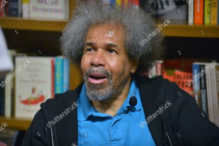Stock Image of Former 'Angola 3' inmate Albert Woodfox sign copies of his book 'Solitary' at Books & Books.