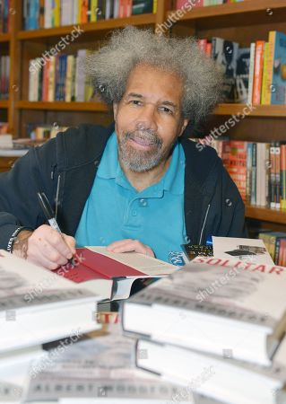 Stock Picture of Former 'Angola 3' inmate Albert Woodfox sign copies of his book 'Solitary' at Books & Books.
