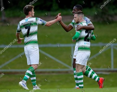 Stock Image of UCD vs Shamrock Rovers. Shamrock Rovers' Daniel Carr celebrates scoring his side's opening goal with Dylan Watts and Jack Byrne