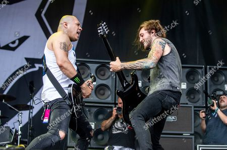 Doc Coyle, Chris Cain. Doc Coyle, left, and Chris Cain of Bad Wolves perform at the Sonic Temple Art and Music Festival at Mapfre Stadium, in Columbus, Ohio