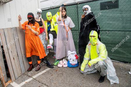 Nadezhda Tolokonnikova, center, of Pussy Riot poses at the Sonic Temple Art and Music Festival at Mapfre Stadium, in Columbus, Ohio