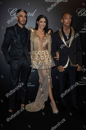 Adam Abaida Atarshi, Andreea Sasu, Jeremy Meeks. Adam Abaida Atarshi, Andreea Sasu and Jeremy Meeks pose for photographers upon arrival at the Chopard Love event at the 72nd international film festival, Cannes, southern France
