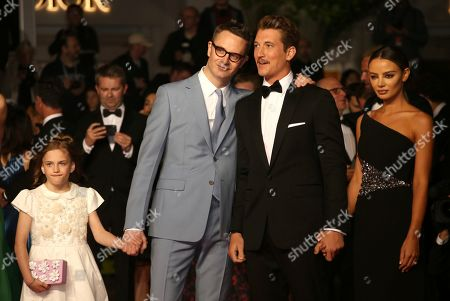 Nicolas Winding Refn, Miles Teller, Keleigh Sperry. Director Nicolas Winding Refn, actor Miles Teller and Keleigh Sperry pose for photographers upon arrival at the premiere of the film 'Too old to Die Young' at the 72nd international film festival, Cannes, southern France