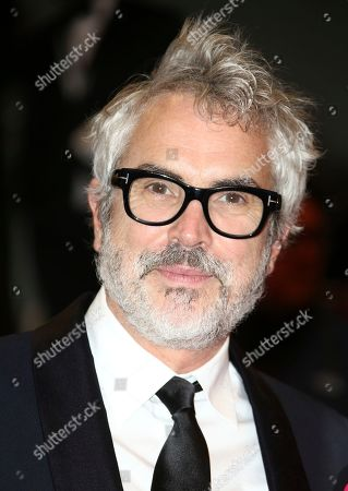 Alfonso Cuaron poses for photographers upon arrival at the premiere of the film 'Too Old to Die Young' at the 72nd international film festival, Cannes, southern France