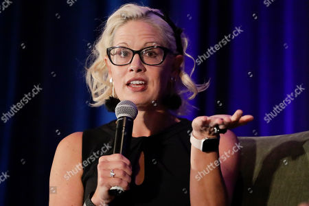 Sen. Kyrsten Sinema, D-Ariz. speaks during a luncheon at the Arizona Biltmore, in Phoenix. Arizona Senators Sinema and Martha McSally spoke to a crowd at an Arizona Chamber of Commerce and Industry event to give an update on action in Washington, D.C