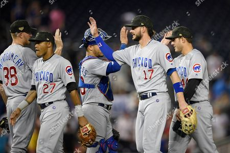 Chicago Cubs' Kris Bryant (17) celebrates with Mike Montgomery (38), Addison Russell (27), Willson Contreras (40) and Anthony Rizzo (44) after a baseball game against the Washington Nationals, in Washington
