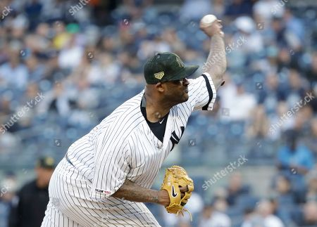 9c59b7918 New York Yankees  CC Sabathia delivers a pitch during the first inning of  the team s
