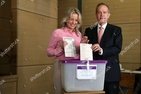 Australian Opposition Labor leader Bill Shorten (R) and his wife Chloe (L) pose for photos as the cast their votes at Moonee Ponds West Primary school in Melbourne, Australia, 18 May 2019. Approximately 16.5 million Australians will vote in what is tipped to be a tight election, contest between Australian Prime Minister Scott Morrison and Australian Opposition Labor leader Bill Shorten.