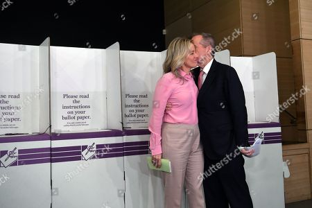 Australian Opposition Labor leader Bill Shorten (L) and his wife Chloe (R) speak as the cast their votes at Moonee Ponds West Primary school in Melbourne, Australia, 18 May 2019. Approximately 16.5 million Australians will vote in what is tipped to be a tight election, contest between Australian Prime Minister Scott Morrison and Australian Opposition Labor leader Bill Shorten.