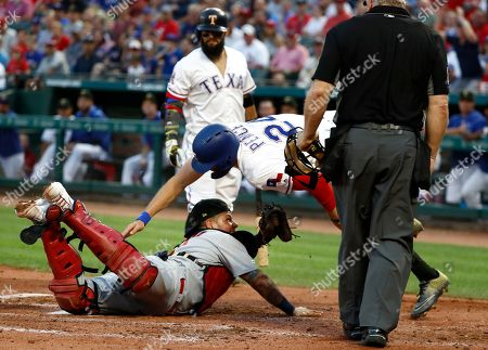 Rougned Odor, Hunter Pence, Yadier Molina, Bill Miller. Home plate umpire Bill Miller, front right, watches as St. Louis Cardinals catcher Yadier Molina, bottom, prepares to tag out Texas Rangers' Hunter Pence (24) who was trying to score from third on a Rougned Odor, rear, at-bat in the second inning of a baseball game in Arlington, Texas