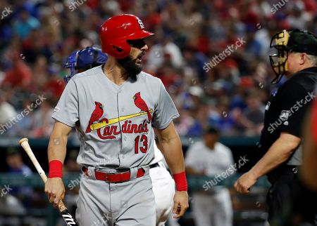 Matt Carpenter, Bill Miller. St. Louis Cardinals' Matt Carpenter (13) shouts back at umpire Bill Miller, right rear, after being called out on strikes in the seventh inning of a baseball game against the Texas Rangers in Arlington, Texas
