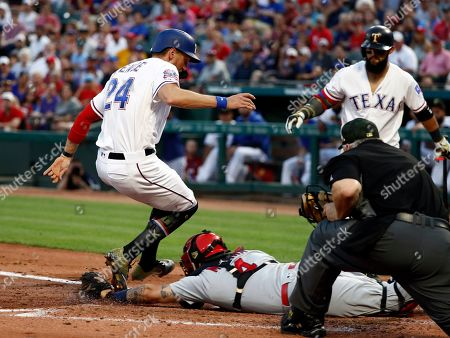 Hunter Pence, Rougned Odor, Bill Miller, Yadier Molina. Texas Rangers' Hunter Pence (24) runs around the attempted tag by St. Louis Cardinals' Yadier Molina (4) and umpire Bill Miller and Rougned Odor (12), rear, watch in the second inning of a baseball game in Arlington, Texas, . Pence, who was tagged out on the play, was trying to score from third in the Odor at-bat