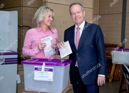 Australian opposition leader Bill Shorten poses as he votes with his wife Chloe during a federal election at Moonee Ponds West Primary School in Melbourne, Australia, .Polling stations opened across Australia on Saturday in elections that are likely to deliver the nation's sixth prime minister in as many years