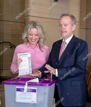 Australian opposition leader Bill Shorten poses as he votes with his wife Chloe during a federal election at Moonee Ponds West Primary School in Melbourne, Australia, . Polling stations opened across Australia on Saturday in elections that are likely to deliver the nation's sixth prime minister in as many years