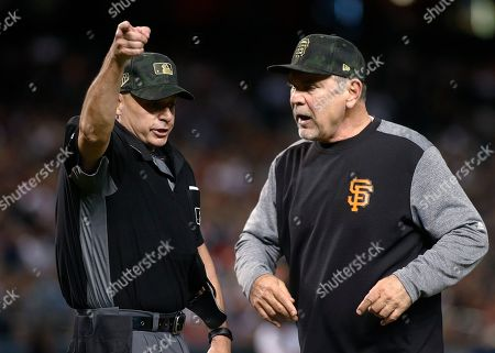 San Francisco Giants manager Bruce Bochy, right, is ejected by home plate umpire Andy Fletcher after arguing a call during the seventh inning of the team's baseball game against the Arizona Diamondbacks, in Phoenix