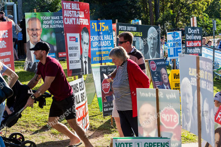 People queue to vote outside a ballot station at Patricks Road State School on Election Day in Brisbane, Australia, 18 May 2019. Approximately 16.5 million Australians will vote in what is tipped to be a tight election, contest between Australian Prime Minister Scott Morrison and Australian Opposition Labor leader Bill Shorten.