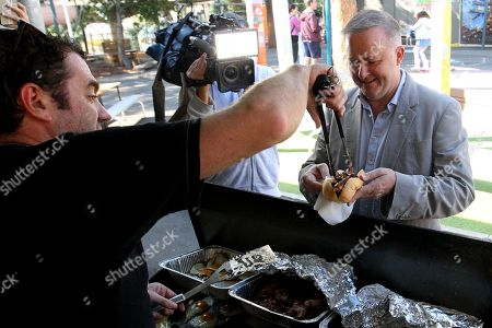 Shadow Infrastructure Minister and Member for Grayndler Anthony Albanese eats a sausage after casting his vote at Nicholson Street Public School in Sydney, Australia, 18 May 2019. Approximately 16.5 million Australians will vote in what is tipped to be a tight election contest between Australian Prime Minister Scott Morrison and Australian Opposition Labor leader Bill Shorten.