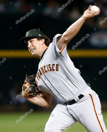 San Francisco Giants pitcher Derek Holland throws against the Arizona Diamondbacks during the seventh inning of a baseball game, in Phoenix