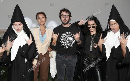Josh Groban poses with an Angel, a Demon and two Nuns