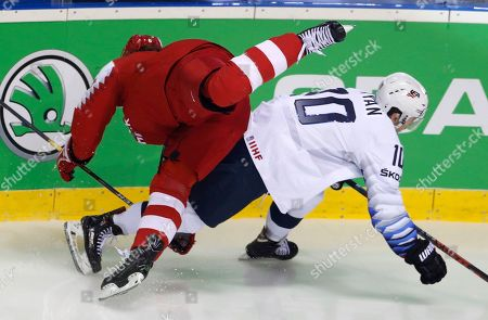 Stock Image of Denmark's Stefan Lassen, left, collides with Derek Ryan of the US, right, during the Ice Hockey World Championships group A match between Denmark and the United States at the Steel Arena in Kosice, Slovakia