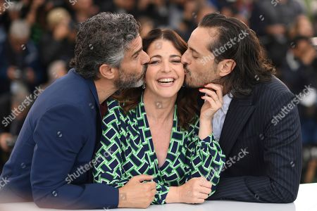 Leonardo Sbaraglia, Nora Navas, Asier Etxeandia. Actors Leonardo Sbaraglia, Nora Navas, and Asier Etxeandia pose for photographers at the photo call for the film 'Pain and Glory' at the 72nd international film festival, Cannes, southern France