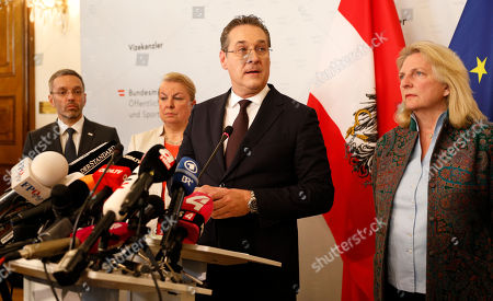 Stock Photo of Austria's Vice-Chancellor Heinz Christian Strache (C) of the Austrian Freedom Party (FPOe) gives a statement to journalists as Interior Minister Herbert Kickl (L) and Foreign Minister Karin Kneissl (R) listen in the Ministry of Public Service and Sport in Vienna, Austria, 18 May 2019. Austrian Vice Chancellor Strache on 18 May 2019 said he will step down from his post as media caught the far-right FPOe's leader Strache in a corruption allegations scandal. German media have on 17 May 2019 published a secretly recorded video of Strache in Ibiza in July 2017, where Heinz-Christian Strache is claimed to meet an alleged niece of a unknown Russian oligarch who wanted to invest large sums of money in Austria.
