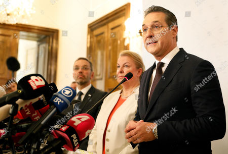 Stock Photo of Austria's Vice-Chancellor Heinz Christian Strache (R) of the Austrian Freedom Party (FPOe) gives a statement to the journalists as Labour Minister Beate Hartinger-Klein (C) and Interior Minister Herbert Kickl (L) listen in the Ministry of Public Service and Sport in Vienna, Austria, 18 May 2019. Austrian Vice Chancellor Strache on 18 May 2019 said he will step down from his post as media caught the far-right FPOe's leader Strache in a corruption allegations scandal. German media have on 17 May 2019 published a secretly recorded video of Strache in Ibiza in July 2017, where Heinz-Christian Strache is claimed to meet an alleged niece of a unknown Russian oligarch who wanted to invest large sums of money in Austria.