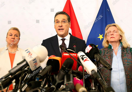 Austria's Vice-Chancellor Heinz Christian Strache (C) of the Austrian Freedom Party (FPOe) gives a statement to journalists as  Minister Beate Hartinger-Klein (L) and Foreign Minister Karin Kneissl (R) listen in the Ministry of Public Service and Sport in Vienna, Austria, 18 May 2019. Austrian Vice Chancellor Strache on 18 May 2019 said he will step down from his post as media caught the far-right FPOe's leader Strache in a corruption allegations scandal. German media have on 17 May 2019 published a secretly recorded video of Strache in Ibiza in July 2017, where Heinz-Christian Strache is claimed to meet an alleged niece of a unknown Russian oligarch who wanted to invest large sums of money in Austria.