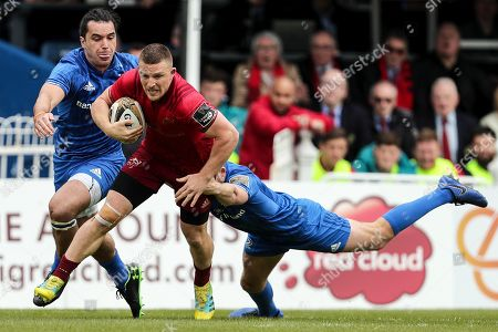 Leinster vs Munster. Munster's Andrew Conway with James Lowe and Ross Byrne of Leinster