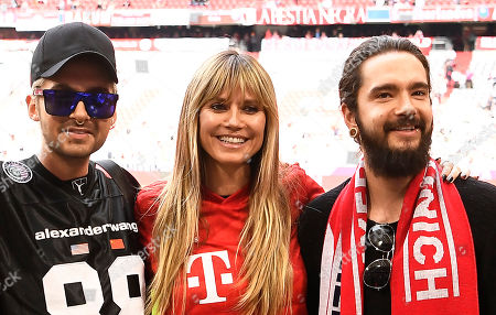 German model Heidi Klum (C) and musicians Tom Kaulitz (R) and Bill Kaulitz (L) of German band 'Tokio Hotel' pose before the German Bundesliga soccer match between FC Bayern Munich and Eintracht Frankfurt in Munich, Germany, 18 May 2019.