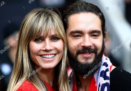 Former German model Heidi Klumm, left, and her partner and member of the band 'Tokio Hotel', Tom Kaulitz, right, pose for the media prior to the German Bundesliga soccer match between FC Bayern Munich and Eintracht Frankfurt in Munich, Germany