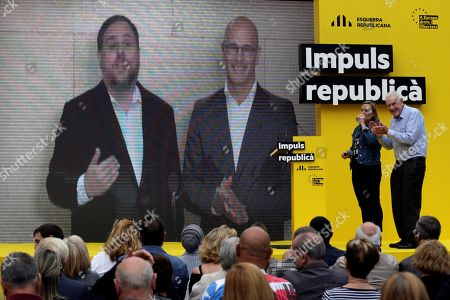 Stock Image of Catalan pro-independence Esquerra Republicana de Catalunya (ERC) imprisoned leader and elected Member in Parliament Oriol Junqueras (L, on the screen), and elected Member in Parliament Raul Romeva (R, on the screen), speak during a video conference from prison at a party's election campaign event in Barcelona, northeastern Spain, 18 May 2019.