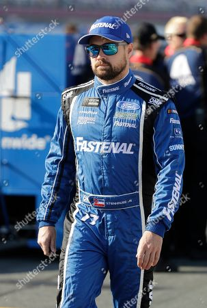 Ricky Stenhouse Jr. walks down pit road before qualifying for Saturday's NASCAR All-Star Cup series auto race at Charlotte Motor Speedway in Concord, N.C