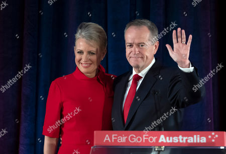 Australian Labor leader Bill Shorten stands on stage with his wife Chloe, at the Federal Labor Reception in Melbourne, Australia, . Shorten has conceded defeat to Prime Minister Scott Morrison in the country's general election. Shorten made the announcement to supporters of his opposition Labor party late Saturday night in Melbourne