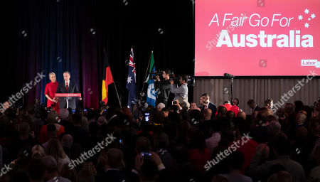 Australian Labor leader Bill Shorten speaks on stage with his wife Chloe, at the Federal Labor Reception in Melbourne, Australia, . Shorten has conceded defeat to Prime Minister Scott Morrison in the country's general election. Shorten made the announcement to supporters of his opposition Labor party late Saturday night in Melbourne