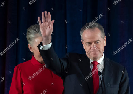 Australian Labor leader Bill Shorten gestures on stage with his wife Chloe, at the Federal Labor Reception in Melbourne, Australia, . Shorten has conceded defeat to Prime Minister Scott Morrison in the country's general election. Shorten made the announcement to supporters of his opposition Labor party late Saturday night in Melbourne