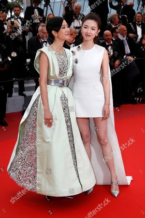 Stock Image of Kwai Lun-Mei (L) and Chinese actress Regina Wan leave the screening of â??Nan Fang Che Zhan De Ju Hui' (The Wild Goose Lake) during the 72nd annual Cannes Film Festival, in Cannes, France, 18 May 2019. The movie is presented in the Official Competition of the festival which runs from 14 to 25 May.