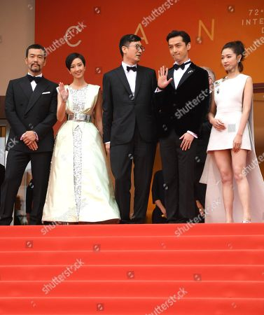 Liao Fan, Kwai Lun-Mei, Diao Yinan, Hu Ge, Wan Qian. Actors Liao Fan, from left, Kwai Lun-Mei, director Diao Yinan, actors Hu Ge and Wan Qian pose for photographers upon arrival at the premiere of the film 'The Wild Goose Lake' at the 72nd international film festival, Cannes, southern France