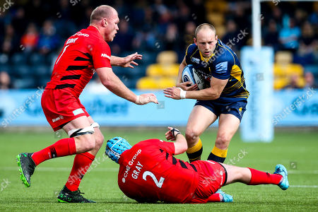 Stock Image of Chris Pennell of Worcester Warriors takes on Joe Gray of Saracens and Schalk Burger of Saracens