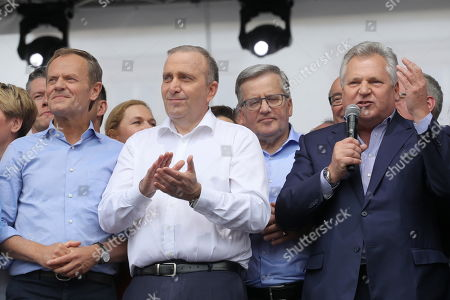 European Council President Donald Tusk (L), chief of the main opposition party, the Civic Platform (PO) Grzegorz Schetyna (C), and former Polish Presidents Bronislaw Komorowski (2-R) and Aleksander Kwasniewski (R) are taking part in the march under the slogan 'Poland in Europe' in Warsaw, Paolnd, 18 May 2019. Politicians and supporters of the European Coalition declared during their march the attachment to the universal European values of freedom, equality and brotherhood.