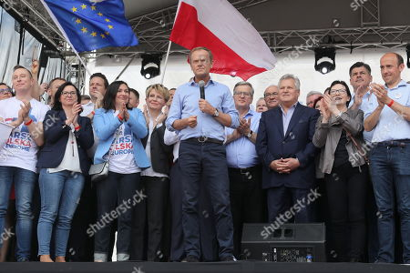European Council President Donald Tusk (C) and former Polish Presidents Bronislaw Komorowski (4-R) and Aleksander Kwasniewski (3-R) taking part in the march under the slogan 'Poland in Europe' in Warsaw, Paolnd, 18 May 2019. Politicians and supporters of the European Coalition declared during their march the attachment to the universal European values of freedom, equality and brotherhood.