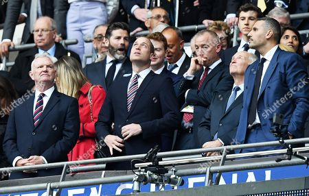 Stock Photo of Greg Clarke (L), chairman of the English FA, Prince William (L), president of the English FA, and Manchester City chairman Khaldoon Al Mubarak (R) wait for the start of the victory ceremony after the English FA Cup final between Manchester City and Watford at Wembley Stadium in London, Britain, 18 May 2019. Manchester City won 6-0.