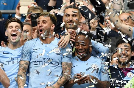 Manchester City chairman Khaldoon Al Mubarak (C top) and players celebrate after the English FA Cup final between Manchester City and Watford at Wembley Stadium in London, Britain, 18 May 2019. Manchester City won 6-0.