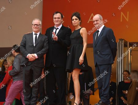 Thierry Fremaux, Quentin Tarantino, Daniela Pick, ierre Lescure. Festival director Thierry Fremaux, from left, film director Quentin Tarantino, Daniela Pick and festival president Pierre Lescure pose for photographers upon arrival at the premiere of the film 'The Wild Goose Lake' at the 72nd international film festival, Cannes, southern France