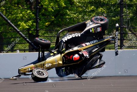 James Hinchcliffe, of Canada, goes airborne after hitting the wall in the second turn during qualifications for the Indianapolis 500 IndyCar auto race at Indianapolis Motor Speedway, in Indianapolis