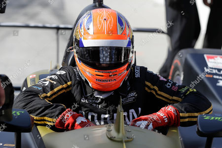 James Hinchcliffe, of Canada, climbs out of his car during qualifications for the Indianapolis 500 IndyCar auto race at Indianapolis Motor Speedway, in Indianapolis