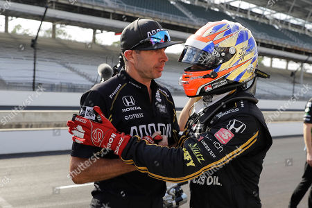 James Hinchcliffe, of Canada, talks with a crew member during qualifications for the Indianapolis 500 IndyCar auto race at Indianapolis Motor Speedway, in Indianapolis