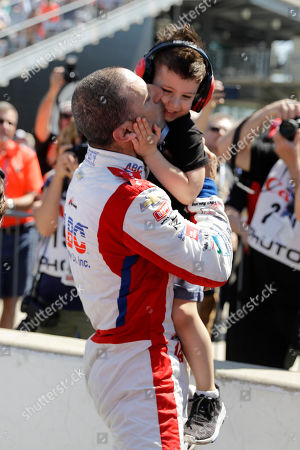 Tony Kanaan, of Brazil, kisses his son Deco after he qualified for the Indianapolis 500 IndyCar auto race at Indianapolis Motor Speedway, in Indianapolis