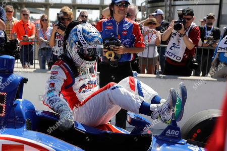 Tony Kanaan, of Brazil, climbs out of his car after qualified for the Indianapolis 500 IndyCar auto race at Indianapolis Motor Speedway, in Indianapolis