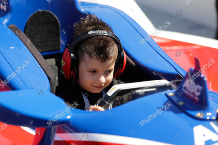 Deco Kanaan sits the the car after his father Tony Kanaan, of Brazil, during qualifying for the Indianapolis 500 IndyCar auto race at Indianapolis Motor Speedway, in Indianapolis